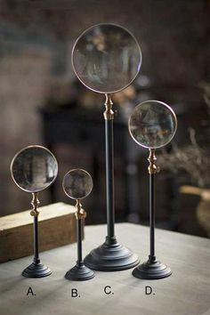 Telescoping Brass Magnifying Stands in Blackened metal and Brass. Could easily attach magnifying glasses to pretty stands/candle sticks