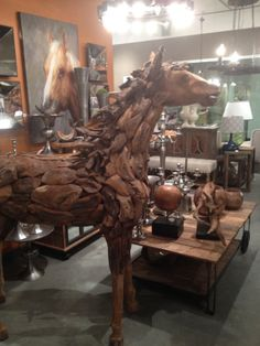 A horse sculpture in front of a horse painting for the equestrian side of us all #homedecor #interiordesign #accessories