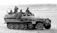 A SdKfz 251/1 halftrack performing reconnaissance duties with numbers of  grenadiers