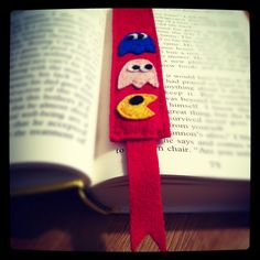 Handmade bookmark. You can find this http://www.etsy.com/listing/114114511/felt-bookmark-with-pac-man-and-its?ref=pr_shop