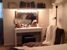 DIY makeup vanity - Malm dressing table with pull out drawer and self from IKEA.  Vanity light bar Home Depot.