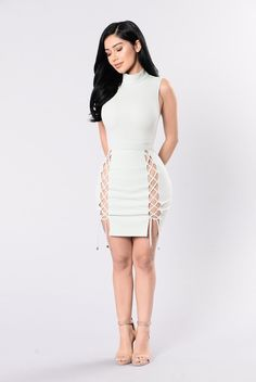 - Available in Sage and Light Pink - Lace Up Dress - Sleeveless - Mock Neck - Knee Length - 95% Polyester 5% Spandex