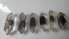 6-A-Natural-Black-Ghost-Crystal-Bone-Double-End-Specimens.jpg (640×360)