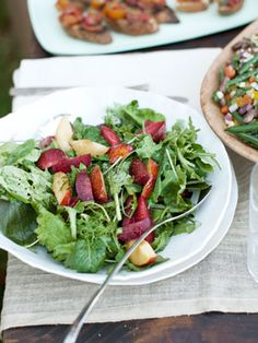 A light vinaigrette dresses a salad of plums, peppery baby mustard greens, and arugula. #recipe #healthy