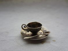 Vintage Silver Charm: Fancy Teacup with Saucer and Spoon