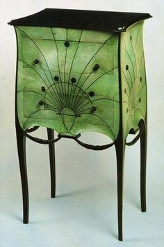 Art Deco: Paul Iribe - Paris, circa 1912 Built in mahogany and tulip interior light mahogany, top slate cladding green tinted green, ebony buttons, ebony base and carved garlands.