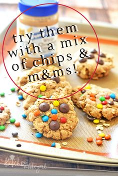 These Flourless M&M Oatmeal Cookies are perfect for packing in lunchboxes, munching on after school or work, and pack a nutritional wallop since they are packed full of oats and peanut butter. Believe me, you'd never guess these thick and chewy cookies are refined flour free! | flourless cookies recipes | gluten free cookies | homemade cookie recipes | healthier cookie recipes | no flour cookie recipes || Kitchen Meets Girl