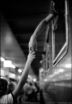 Black and white photo of two people holding hands