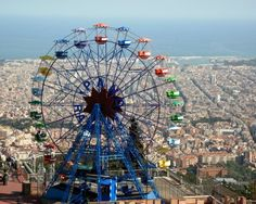 The journey to Tibidabo amusement park starts with a short train ride from the center of Barcelona from there you will take the Tramvia Blau which takes you half way up the mountain. Description from golfuniverse.com. I searched for this on bing.com/images