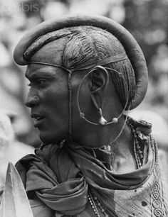 Tanzania | A Maasai dressed to perform a ceremonial dance in honor of Princess Margaret, during her 1956 tour of Tanganyika.  Tabora.  | ©Hulton-Deutsch Collection; photographer Joseph McKeown