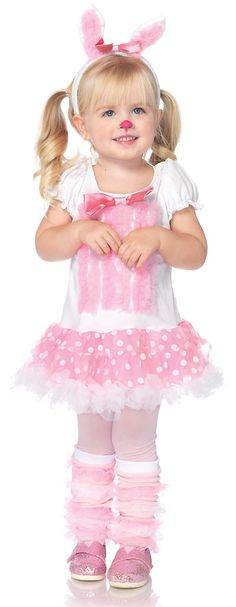 Elmer Fudd wouldn't dare trying to hunt this cute little rabbit in our Fluffy Bunny Kids Costume. Girls will be hopping down the bunny trail on Easter and dress-up for fun play. Our 3-piece kids Fluffy Bunny Costume includes a short white petticoat dress featuring vertical rows of pink ruffles with a pink bow accent on bodice, and a layered polka dot pink petticoat skirt with ruffle trim and an attached fluffy bunny tail, pink ruffled bunny ears headband with pink bow and a pair of ruffled…