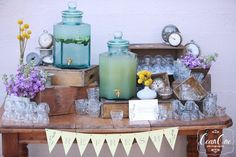 """Ceremony Hydration Station: want to incorporate some of our crates and vintage advertising boxes to help display boxes. Cheri and Katie to help select other items for display. Mom to create a """"Refresh"""" sign on lace and aged, antique hymnal bunting."""