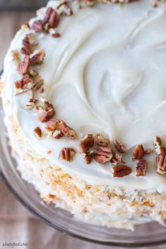 This moist carrot spice cake is the perfect spring dessert! With a thick cream cheese frosting, this cake is decadent and delicious!