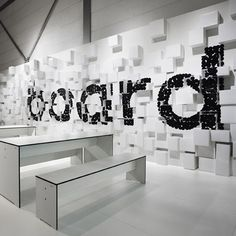 German studio D'art have covered a wall in white paper boxes and spotty black lettering for the German Pulp and Paper Association at a Düsseldorf trade fair.