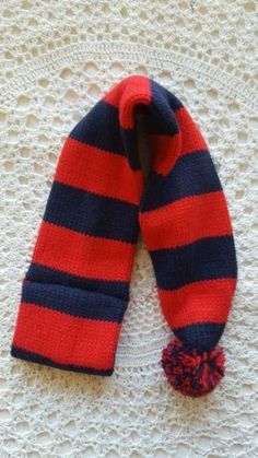 Dog scarf size XS/S knitted red and blue stripe print and puffy ball at the end
