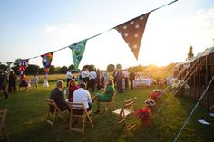 Bunting outside at sunset.    Find out more about our wedding photography at: www.littlephotocompany.co.uk