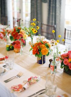 I love color! Bright tins, old pop bottles, and a warm palette of dahlias, garden roses, coreopsis, craespedia, asclepia...Shot by Jose Villa.