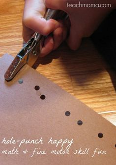 Math and fine motor skill fun using a hole punch! Super simple activity for kids! If you're looking for a great activity to teach fine motor skills, add this to your list! You can teach math at the same time, too! #teachmama #learning #math #mathgames #earlylearning #kidslearning #activitiesforkids #toddler #activities #education #preschoolers #preschool