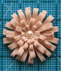 Loopy Flower Tutorial by Tosh. This would make a great brooch