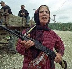 Women should not be surprised that local men would not stretch out their hands to greet them. Women should not do that, either. Men and women in Dagestan greet only with a nod of their heads.Particularly if they are carrying a big gun; local woman with Russian AKM.