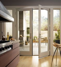 french doors opening from kitchen to the deck