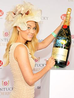 Lauren Conrad signed a bottle of champagne for the Churchill Downs Foundation during the Kentucky Derby