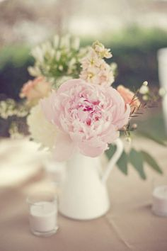 soft pastel colors, small table arrangements