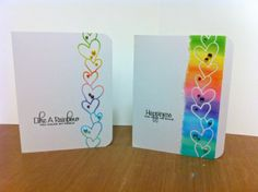 Inspired by Jennifer McGuire's design - I colored the rainbow with Copics and then used both the positive & negative of the Memory Box Twirled Hearts die.  See Jennifer's original card at http://www.jennifermcguireink.com/2012/04/rainbow-bright.html  Sentiments are stamped from PTI's Beautiful Butterflies designed by Maile Belles.