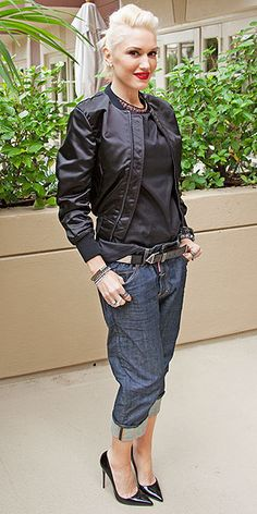 GWEN STEFANI Slouchy boyfriend jeans. Sleek bomber. Red lip. Gwen definitely didn't make any new style resolutions, sticking to her signature look at a Paddington film junket in L.A.