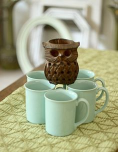 The item for sale is the set of cups but I just love this owl!