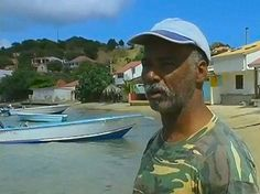 On the Caribbean island of Guadeloupe near the largest city called:Pointe-à-Pitre. This local fisherman was explaining the various fish that he sells from a nearby dock.  1great-trip.com