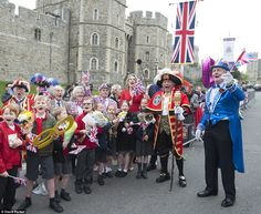 Young supporters: Excited schoolchildren waved flags cheered alongside a town crier and supporters in fancy dress