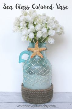 How to transform a plain water jug into a Seaglass Colored Vase. Lovely summer decor idea.