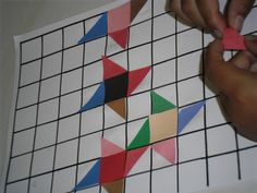 students learned about pioneer days and log cabin quilts.  students designed their own quilt patterns with triangles and squares. K-12 artist residencies available.  Contact us.
