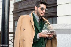 Fashion editor Kadu Dantas wearing a Margiella coat Loja Vitor Alfaiate  blazer and waistcoat Fauve le 53bd9e8277d