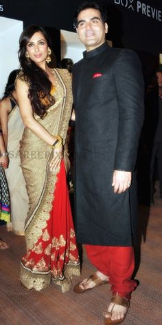 Malaika Arora in a Red n golden Half n Half saree..