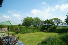 Higher Manhay Barn (1940)  http://www.classic.co.uk/holiday-cottage/desc-1940.html  Surrounded by fields where on clear days Mount's Bay is visible sparkling in the distance, this cottage sleeps 4. — at 7.6 miles W of Falmouth, Cornwall.