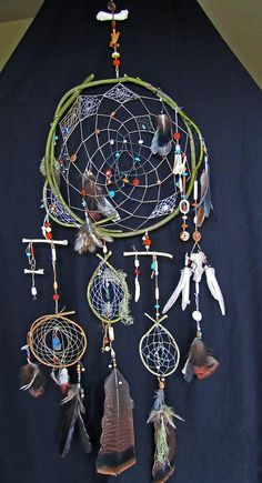 love the idea of weaving smaller dreamcatchers into sections of the whole dream catcher