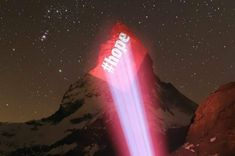 Messages of Hope on the Matterhorn Mountain. The Matterhorn Zermatt illuminated by projections by Gerry Hofstetter during the Corona crisis Message Of Hope, Send Message, Tourism Images, Manchester Central, Swiss Flag, Office Images, Words Of Hope, Geneva Motor Show, Zermatt