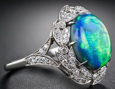 Black opal set in diamonds and platinum...gorgeous !   From Diamonds in the Library