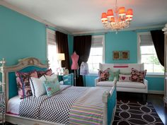 Blue Teen's Bedroom with Mix of Colors and Patterns  --  This bedroom mixes toile, polka dots, an ornate chandelier, a graphic area rug and a heavily carved bed for a whimsical look.