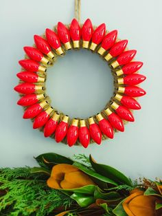 Year after year, colored twinkle light bulbs are certain to burn out. Instead of tossing them out, collect them for decorating wreath forms. Here, an all red wreath is created by adding glue to the backs of discarded red bulbs, then using them to decorate the front of the wreath.