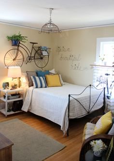 Guest Bedroom with a bicycle as wall art!!!  This would be very simple to DIY by painting an old bike you could find at a yard sale or thrift store (this is from the  2015 Spring Bachmans Ideas House- Itsy Bits And Pieces)