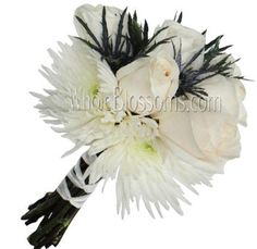 These White Spider Mums and Roses with Blue Purple Eryngium wedding flowers will be the highlight of your wedding.
