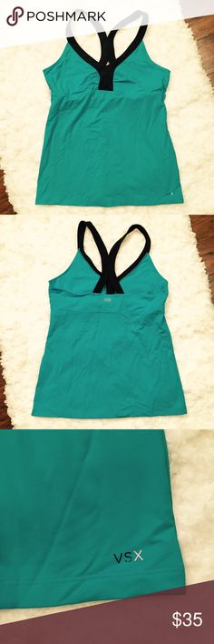 Victoria's Secret Sexy Sport Athletic Top Victoria's Secret Sexy Sport Athletic Top  This athletic tank top comes with a built in bra and racerback style straps. Soft, stretchy material. Excellent condition. The color is what I would call a teal green.   Size large  Approx measurements shown in photos Victoria's Secret Tops Tank Tops