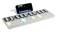 Keys is a music keyboard that let's you learn, play, and create music quickly and easily using LED lights and gestures. $88.00 (1 Keys + iPhone Dock shown in photo)