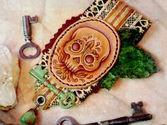 The Verdant Skull - leather & fiber brooch. $60.00, via Etsy.