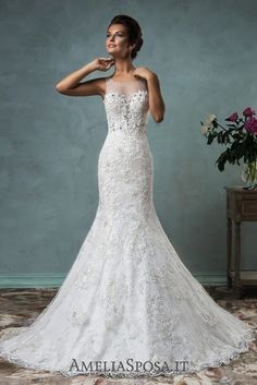 Wedding dress Victoriya - AmeliaSposa. Body lines are emphasized with a purpose. Sophisticated laces, a deep cleavage decorated with Swarovski crystals and transparent back will grab your attention and make this dress unforgettable. However, dense texture hides intimate body parts from others.