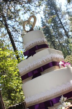 Country inspired wedding cake.  Lace, burlap, and ribbon adorn this beautiful cake.