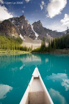 canoe on the lake , awesome mountains